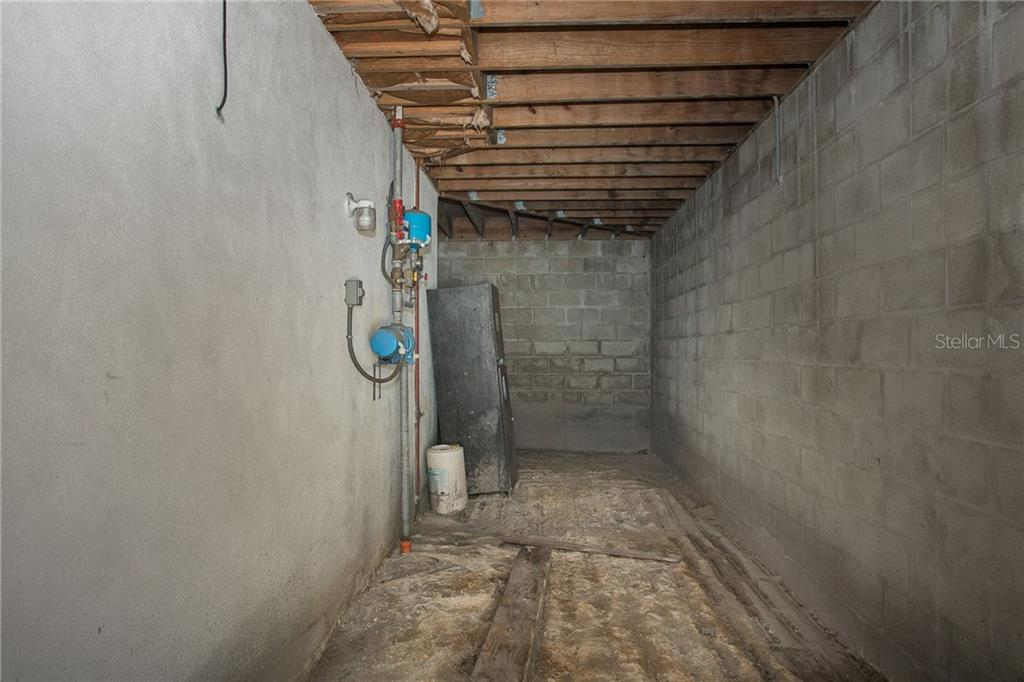 Basement storage room - Single Family Home for sale at 550 S Oxford Dr, Englewood, FL 34223 - MLS Number is D6111512