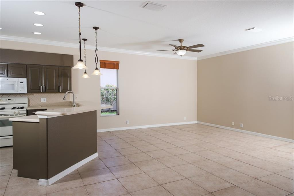 KITCHEN AND FAMILY ROOM - Single Family Home for sale at 3583 Royal Palm Dr, North Port, FL 34288 - MLS Number is D6111716