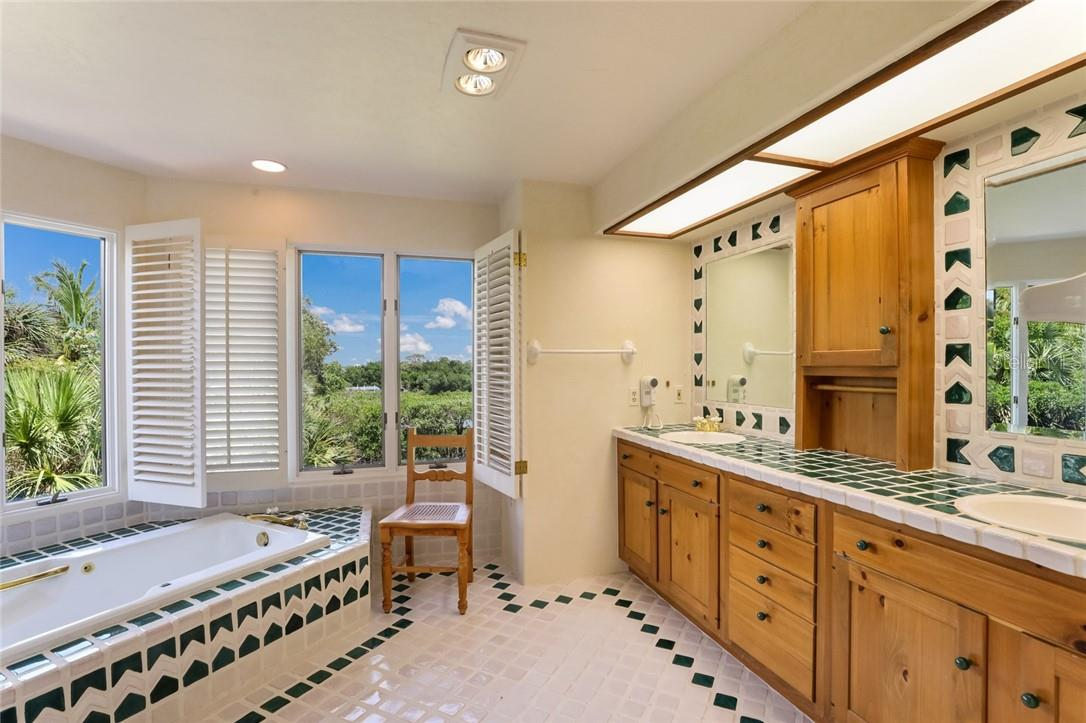 Soak in the views while soaking in the tub in Master bath with exquisite tile work - Single Family Home for sale at 4090 Loomis Ave, Boca Grande, FL 33921 - MLS Number is D6112331