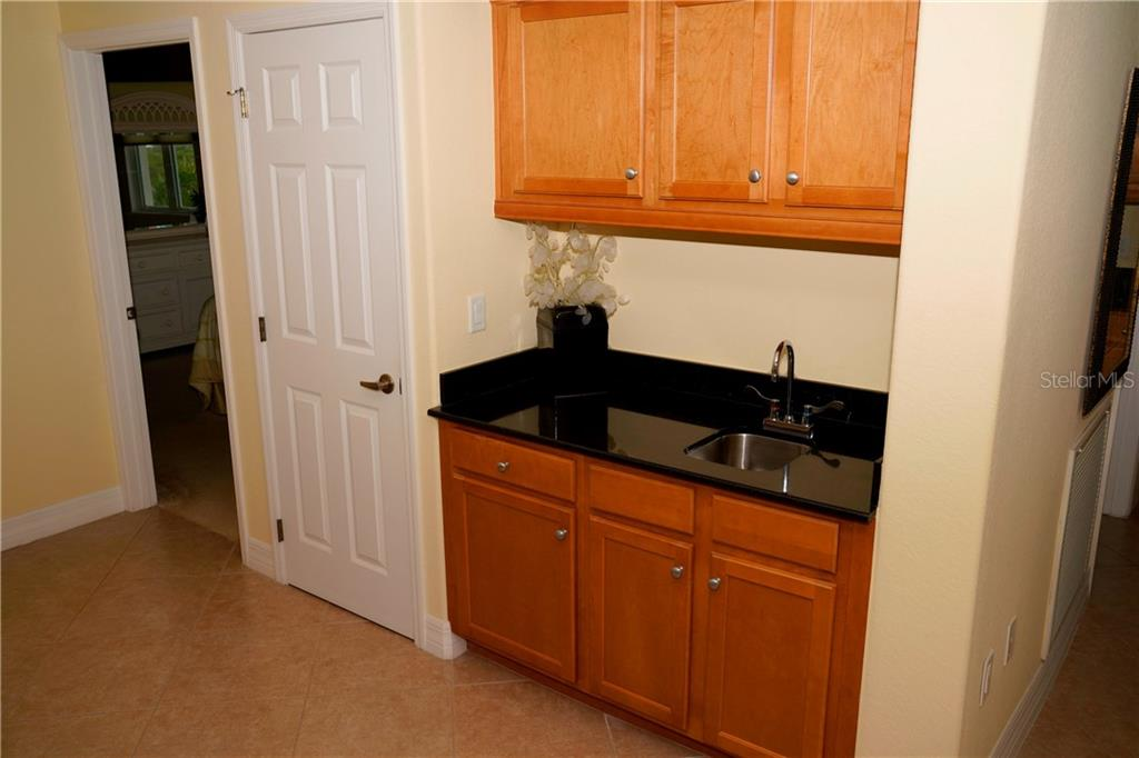 Entertainment corner - wet bar with cabinetry for supplies and water for drinks.  Located off the dining room. Great asset. - Condo for sale at 2245 N Beach Rd #304, Englewood, FL 34223 - MLS Number is D6112346