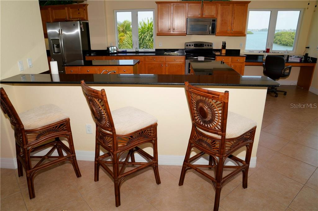 A terrific water view out of the kitchen window from the breakfast bar. - Condo for sale at 2245 N Beach Rd #304, Englewood, FL 34223 - MLS Number is D6112346