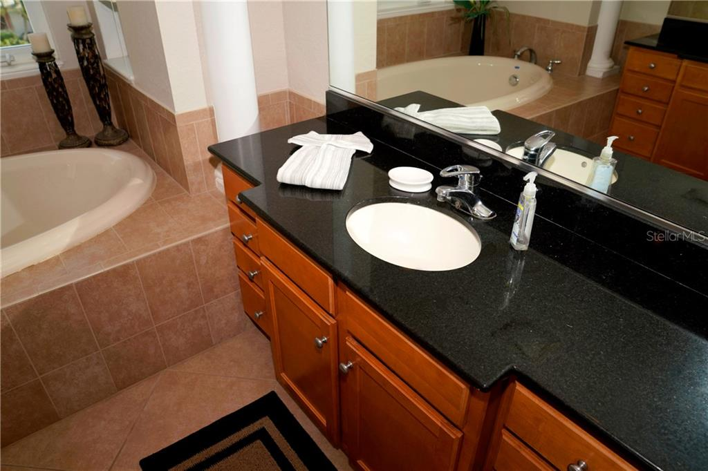 Lots of counter space and cabinet space on each side vanity. - Condo for sale at 2245 N Beach Rd #304, Englewood, FL 34223 - MLS Number is D6112346