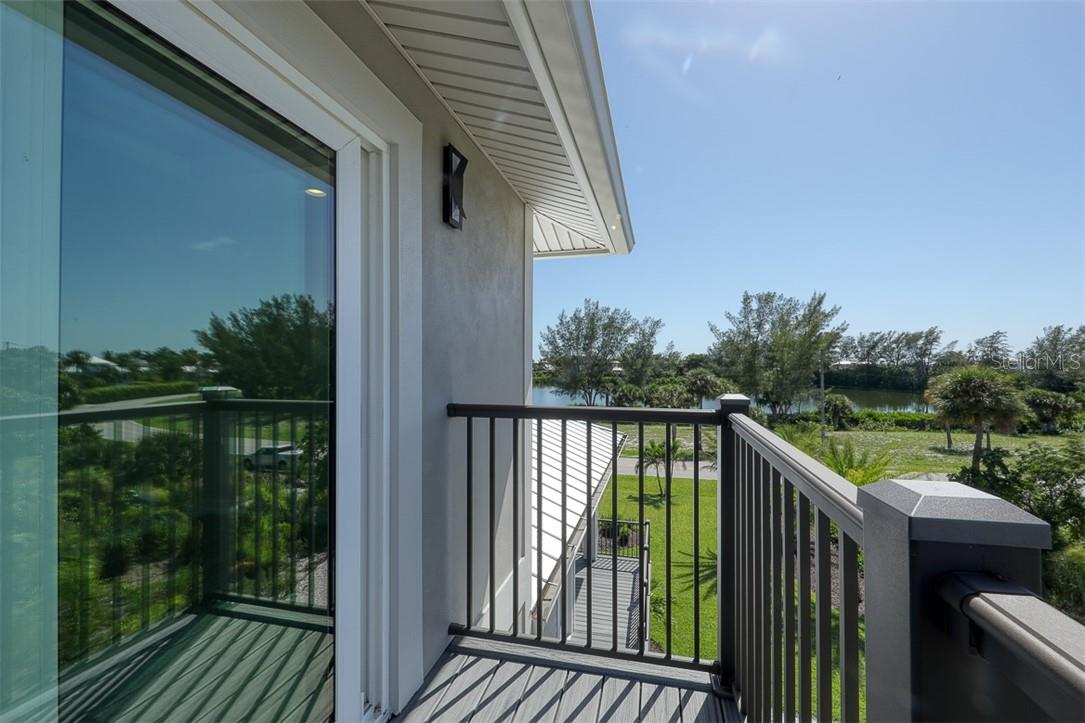 Bedroom 2 with Balcony - Single Family Home for sale at 16070 Gulf Shores Dr, Boca Grande, FL 33921 - MLS Number is D6112557