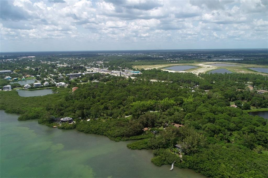property begins north of round house - Vacant Land for sale at 9427 Downing St, Englewood, FL 34224 - MLS Number is D6112667