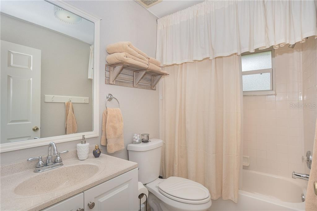 Guest bathroom offers an energy saving feature with automatic lights - Single Family Home for sale at 185 Apollo Dr, Rotonda West, FL 33947 - MLS Number is D6113690