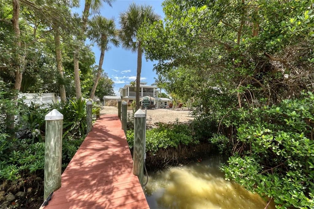 Single Family Home for sale at 550 N Gulf Blvd, Placida, FL 33946 - MLS Number is D6113929