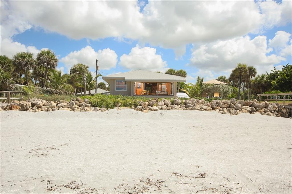 Looking at the Cottage from the Gulf - Single Family Home for sale at 4074 N Beach Rd #Ctg4, Englewood, FL 34223 - MLS Number is D6114111