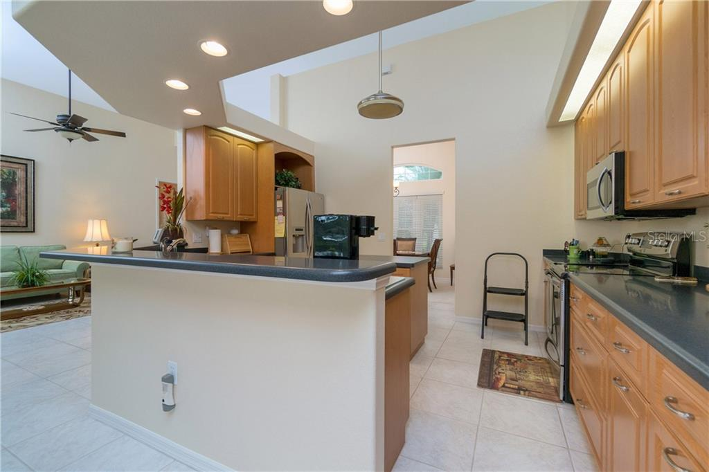 Corian counter breakfast bar! - Single Family Home for sale at 439 Boundary Blvd, Rotonda West, FL 33947 - MLS Number is D6114162