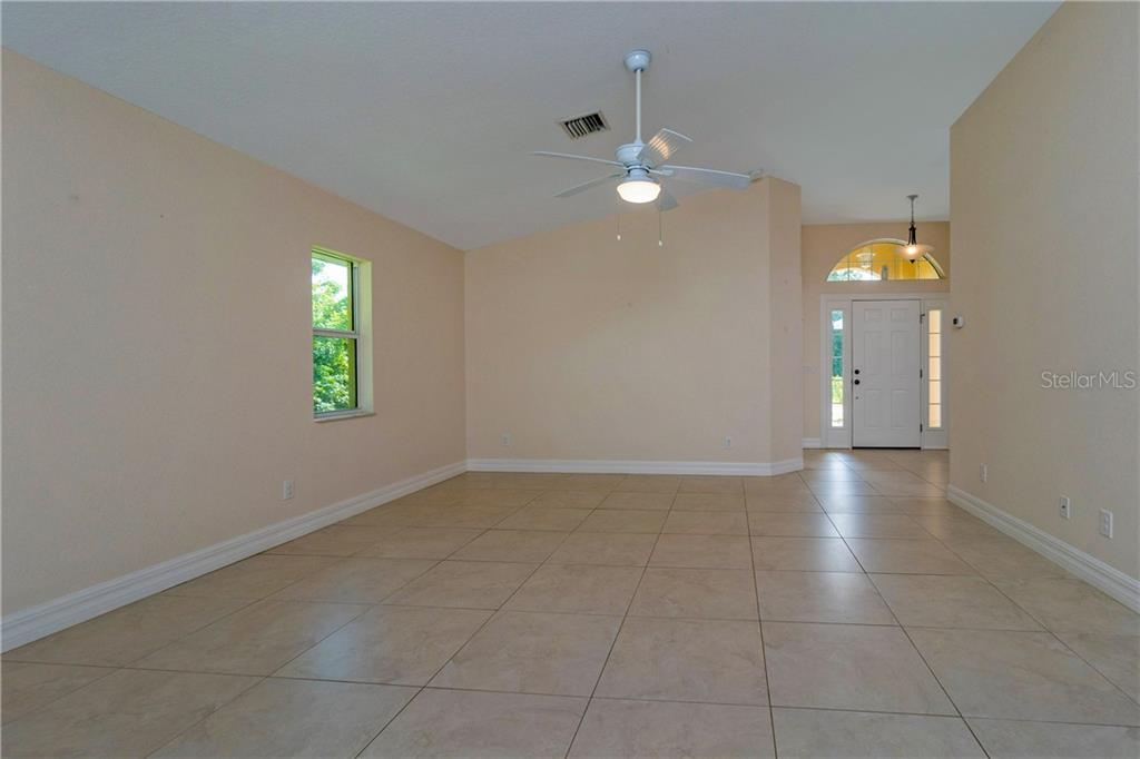 ANOTHER LOOK AT THE GREAT ROOM. - Single Family Home for sale at 112 Boxwood Ln, Rotonda West, FL 33947 - MLS Number is D6114179