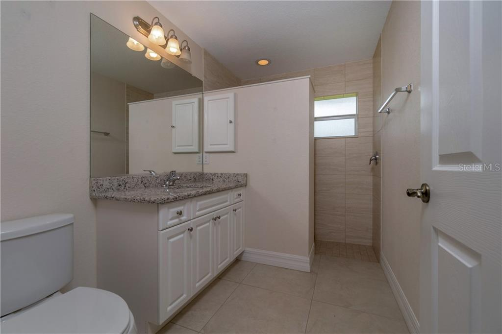 THE MASTER BATHROOM HAS GRANITE COUNTER TOPS AND A WALK IN SHOWER. - Single Family Home for sale at 112 Boxwood Ln, Rotonda West, FL 33947 - MLS Number is D6114179