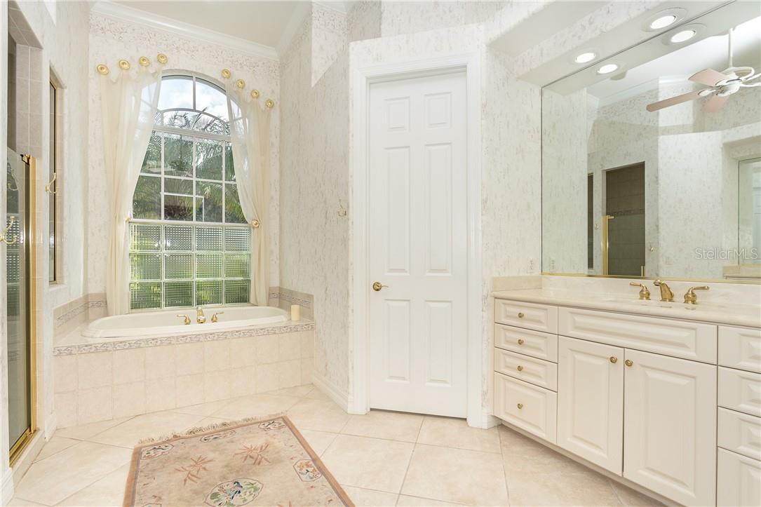 Master Bathroom with 2nd Vanity and all the storage you will ever need !! - Single Family Home for sale at 18 Saint Croix Way, Englewood, FL 34223 - MLS Number is D6114880