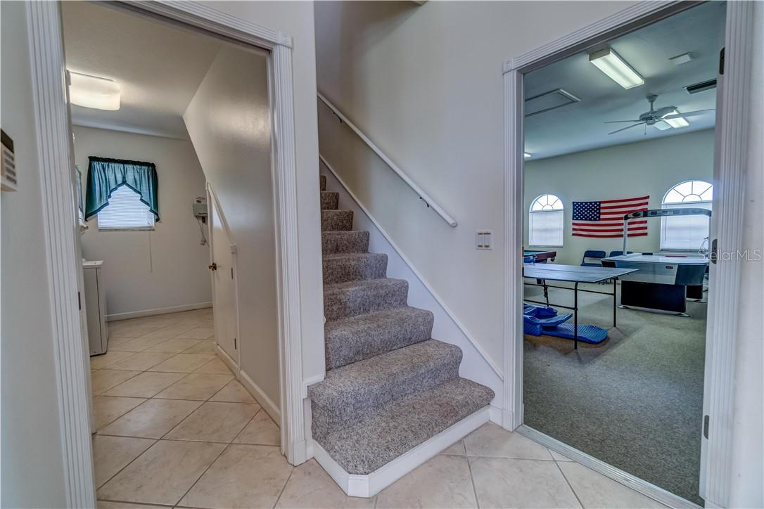 Hmm, where might this staircase lead to? Let's go find out! - Single Family Home for sale at 12307 S Access Rd, Port Charlotte, FL 33981 - MLS Number is D6117140