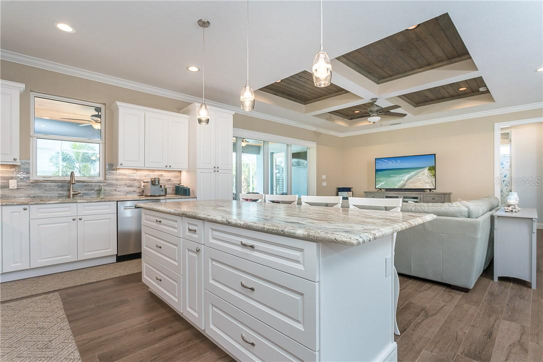 Beautiful granite counters are seen in the kitchen, baths, laundry room and even the outdoor kitchen - Single Family Home for sale at 145 Leland St Se, Port Charlotte, FL 33952 - MLS Number is D6117438