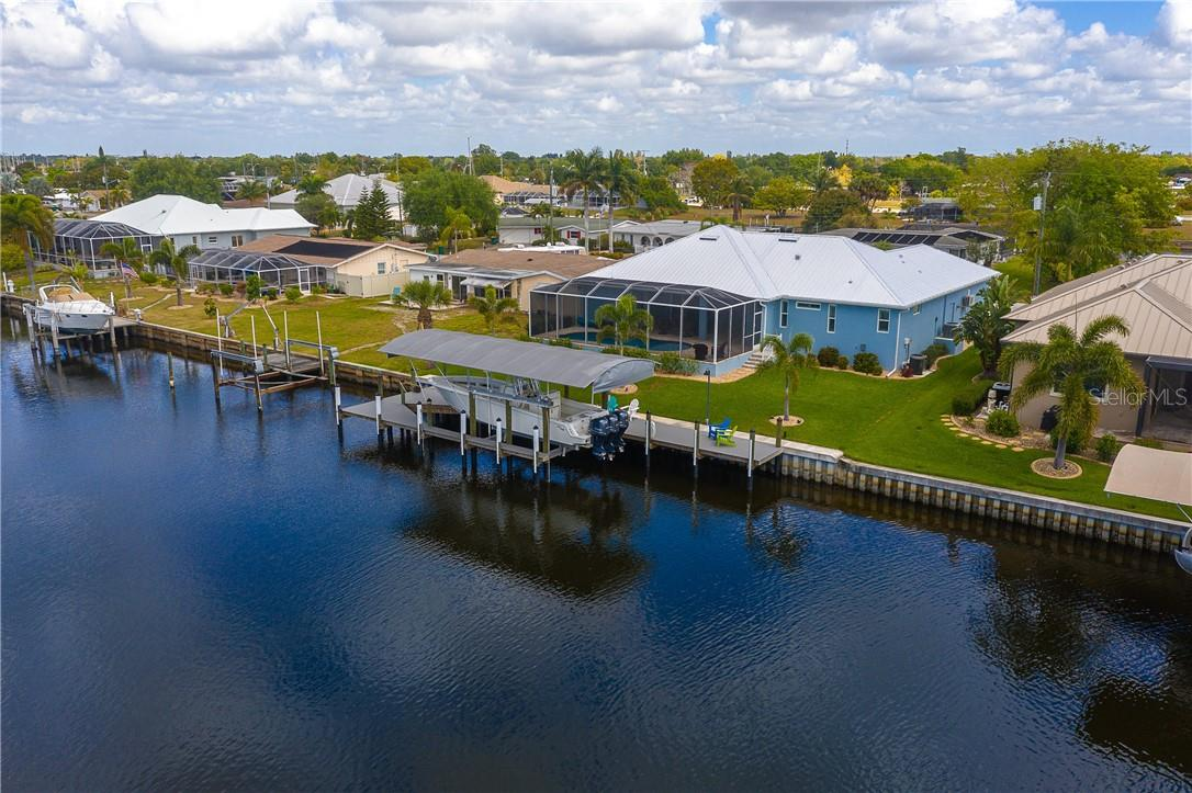 Covered 16,000 lb boat lift with wrap-around dock done in easy care Trex decking - Single Family Home for sale at 145 Leland St Se, Port Charlotte, FL 33952 - MLS Number is D6117438