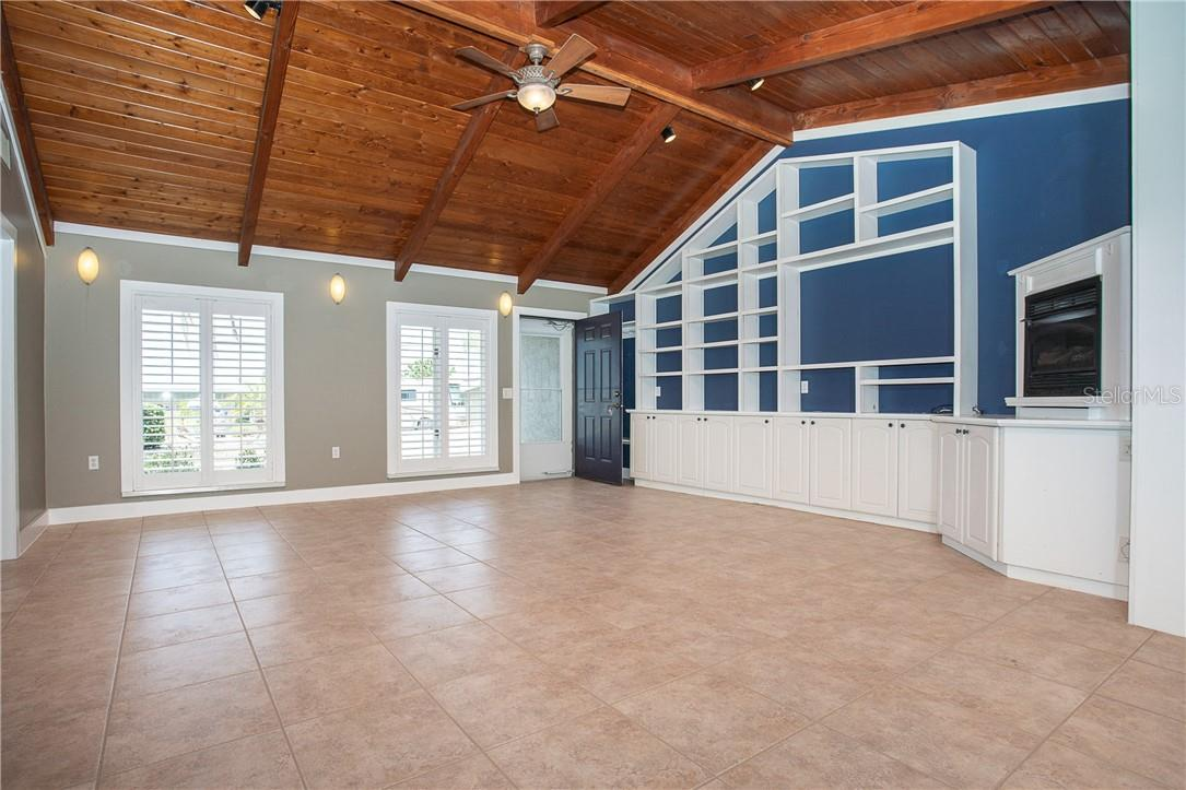 Great Room with beautiful Plantation Shutters & plenty of Built in cabinets for storage - Single Family Home for sale at 1661 New Point Comfort Rd, Englewood, FL 34223 - MLS Number is D6117712