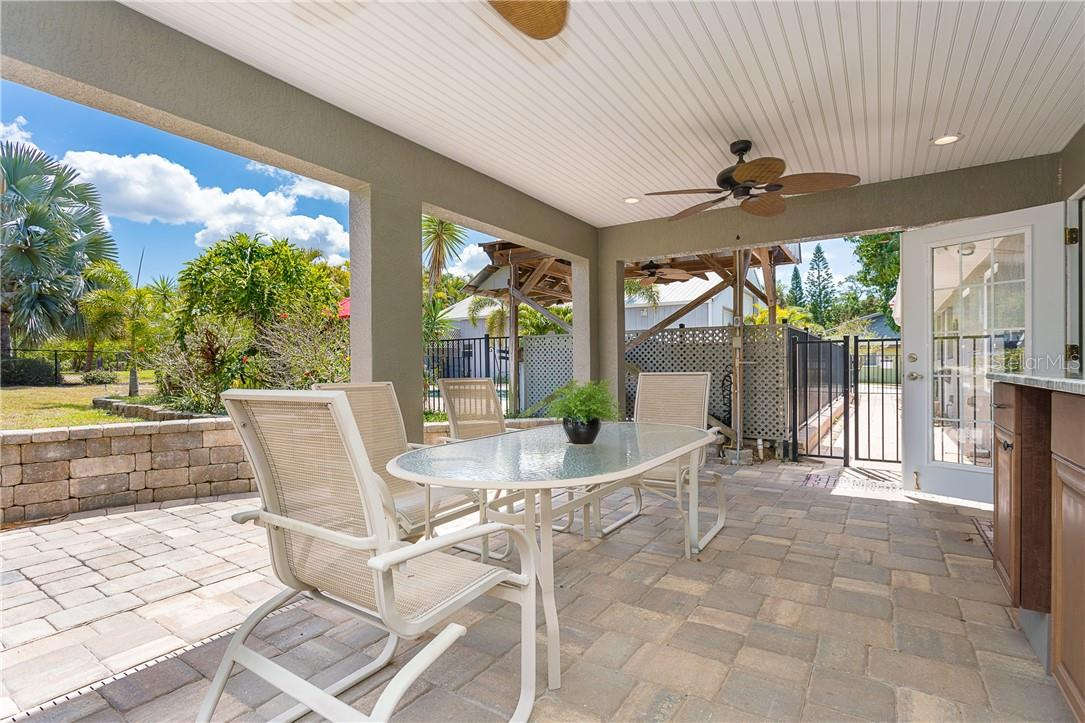 Remarkable Covered Dining area with it's own outside kitchen and storage. - Single Family Home for sale at 1661 New Point Comfort Rd, Englewood, FL 34223 - MLS Number is D6117712