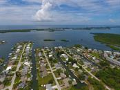 One of the last remaining direct access waterfront lots in Grove City area - Vacant Land for sale at 0 Michigan Ave, Englewood, FL 34224 - MLS Number is D5912495