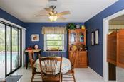 Breakfast Nook overlooking Pool - Single Family Home for sale at 332 Eden Dr, Englewood, FL 34223 - MLS Number is D6100012