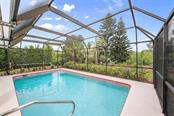 Pool with lush landscaping for privacy - Single Family Home for sale at 332 Eden Dr, Englewood, FL 34223 - MLS Number is D6100012