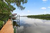 Deep water dock & lift with deep water (sailboat & motor yacht).  No bridges to the ICW and Gulf of Mexico. - Single Family Home for sale at 43 Bayshore Cir, Placida, FL 33946 - MLS Number is D6101722