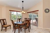 Dining area with plenty of natural light. - Single Family Home for sale at 7256 Holsum St, Englewood, FL 34224 - MLS Number is D6101787