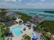 Aerial view of docks, clubhouse, grill area, pool and spa - Condo for sale at 6001 Boca Grande Cswy #e58, Boca Grande, FL 33921 - MLS Number is D6103590