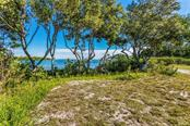 Walkway to boat dock. - Vacant Land for sale at 5040 Grouper Hole Ct, Boca Grande, FL 33921 - MLS Number is D6104626