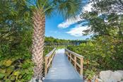Walkway to Dock. - Single Family Home for sale at 540 N Gulf Blvd, Placida, FL 33946 - MLS Number is D6110801