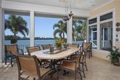 SCREENED WATERFRONT LANAI OVERLOOKING ICW AND POOL! - Single Family Home for sale at 500 Anchor Row, Placida, FL 33946 - MLS Number is D6111649