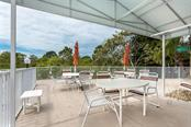 Tables at the pool area - Condo for sale at 6610 Gasparilla Pines Blvd #229, Englewood, FL 34224 - MLS Number is D6117434
