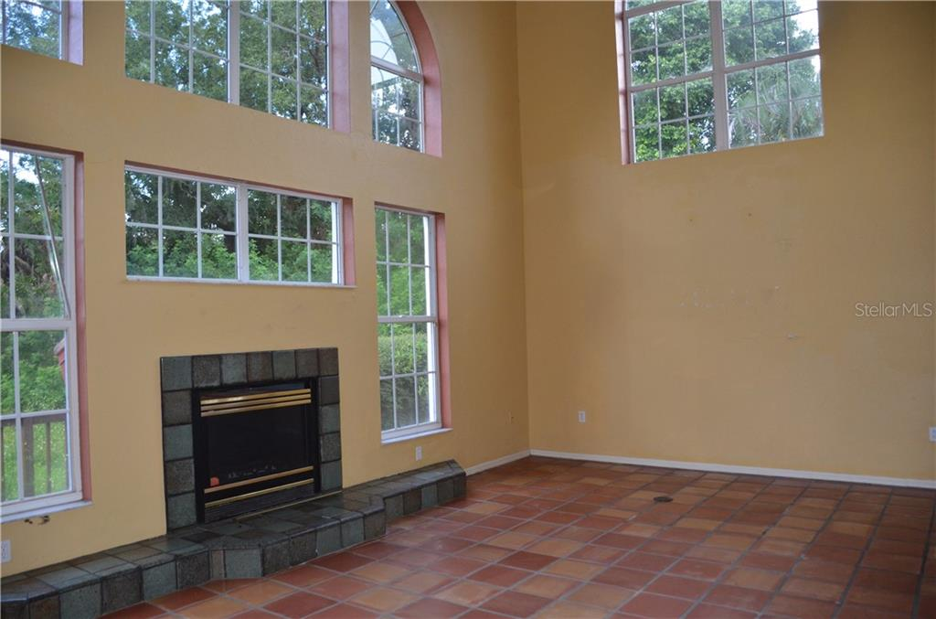 Fireplace in family room - Single Family Home for sale at Address Withheld, Bradenton, FL 34202 - MLS Number is T3132327