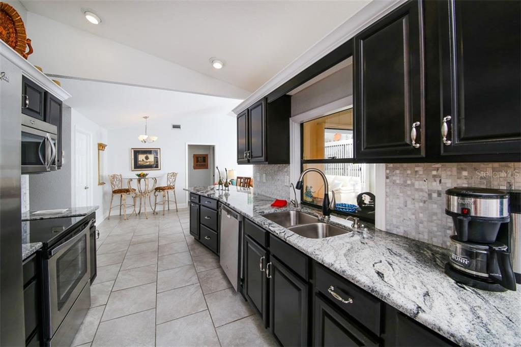 Beautiful tile backsplash and pass through window to the lanai - Single Family Home for sale at 26178 Rampart Blvd, Punta Gorda, FL 33983 - MLS Number is C7240559