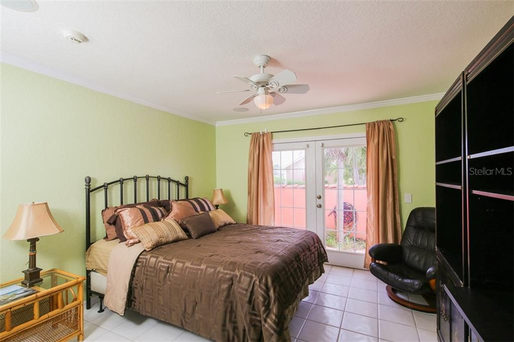 This bedroom could also serve as an office or den with French doors to a front patio - Single Family Home for sale at 1620 Appian Dr, Punta Gorda, FL 33950 - MLS Number is C7242315