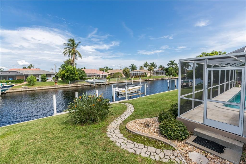 Breakfast nook / dining area with view to pool, lanai and canal - Single Family Home for sale at 890 Coronado Dr, Punta Gorda, FL 33950 - MLS Number is C7243197