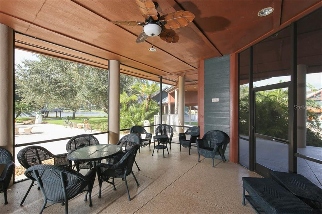 Part of the wonderful covered lanai off clubhouse with beautiful view of the lake - Villa for sale at 1234 Green Oak Trl, Port Charlotte, FL 33948 - MLS Number is C7243720