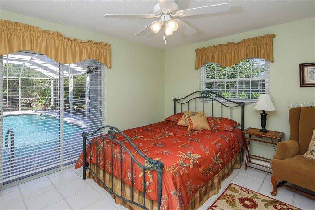 One of 3 guest bedrooms - this one has sliders to the lanai - Single Family Home for sale at 4407 Albacore Cir, Port Charlotte, FL 33948 - MLS Number is C7245070