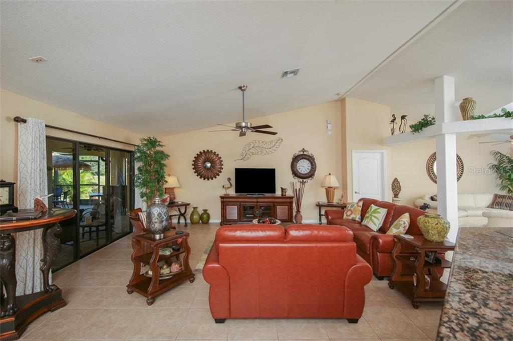 Great room - Single Family Home for sale at 220 Broadmoor Ln, Rotonda West, FL 33947 - MLS Number is C7248036