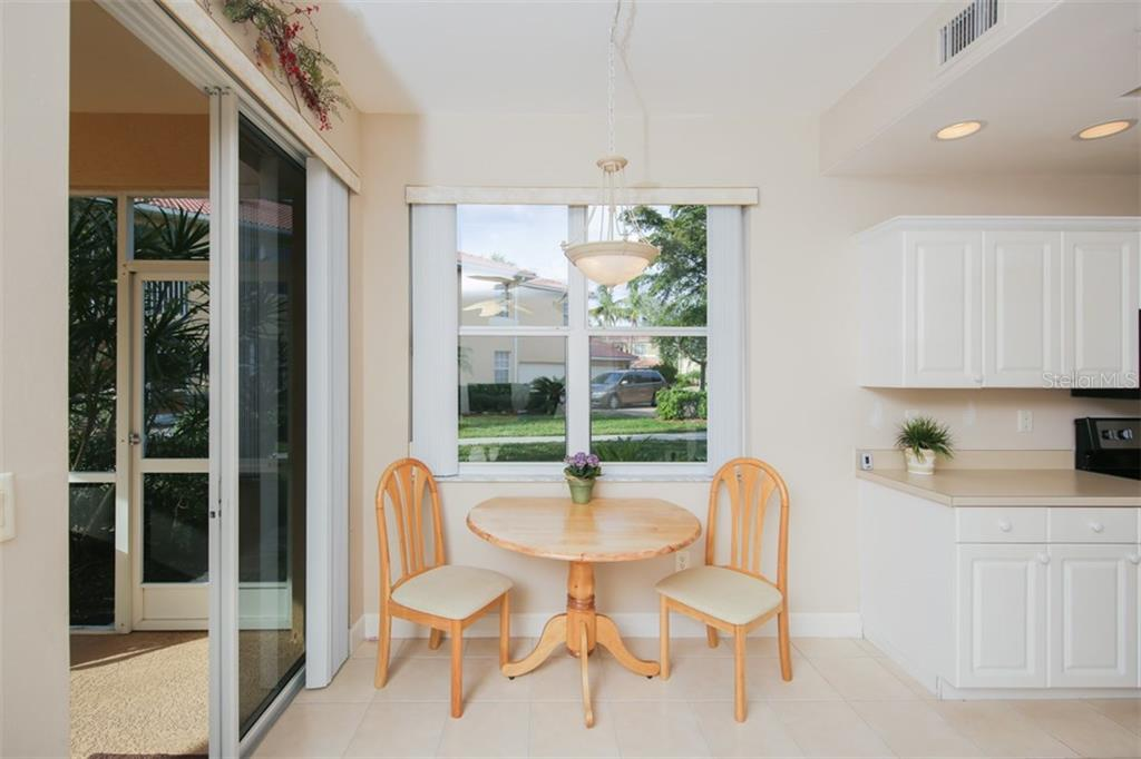 Intimate café area for those quick meals before dashing out the door for a round of golf or tennis match! - Condo for sale at 3392 Sunset Key Cir #b, Punta Gorda, FL 33955 - MLS Number is C7249092