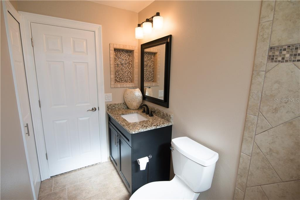 This newly renovated bathroom features a tub and shower as well as an extended vanity. The workmanship throughout this home is notable! - Single Family Home for sale at 3184 Ulman Ave, North Port, FL 34286 - MLS Number is C7400587