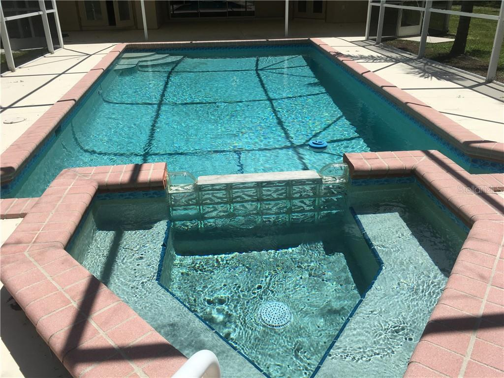 Take a dip in your refreshing pool and spa while enjoying the surrounding nature and blue skies. - Single Family Home for sale at 3184 Ulman Ave, North Port, FL 34286 - MLS Number is C7400587
