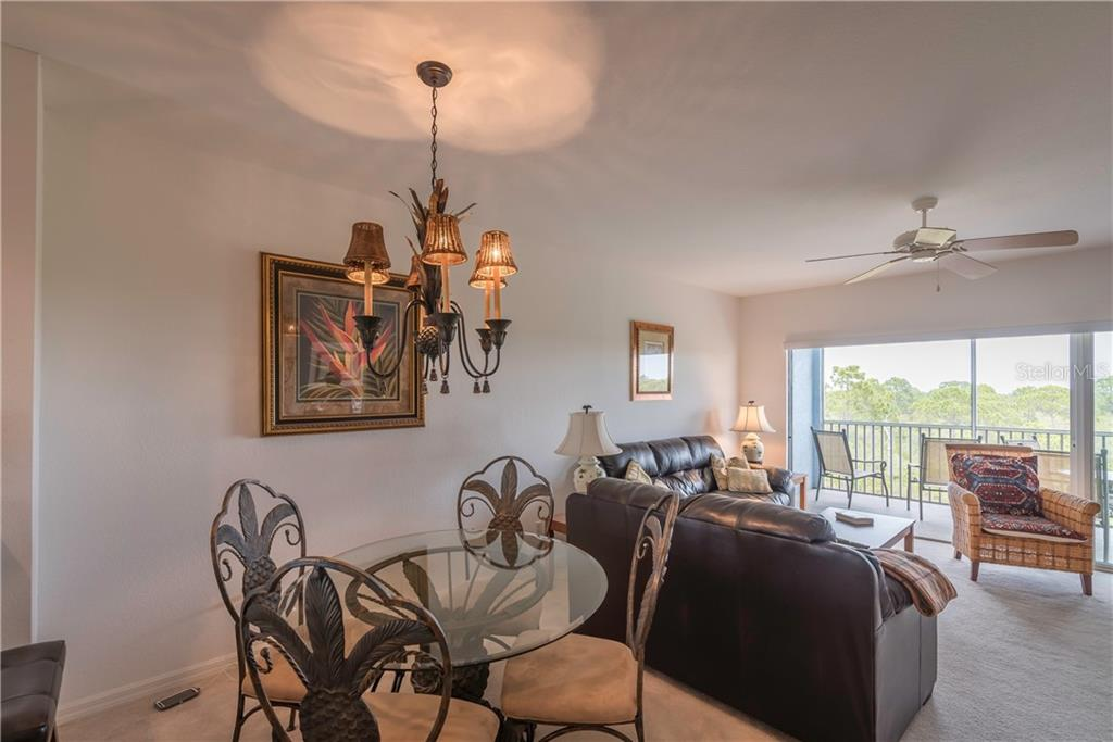 Dining and Living Area. - Condo for sale at 8413 Placida Rd #403, Placida, FL 33946 - MLS Number is C7401304