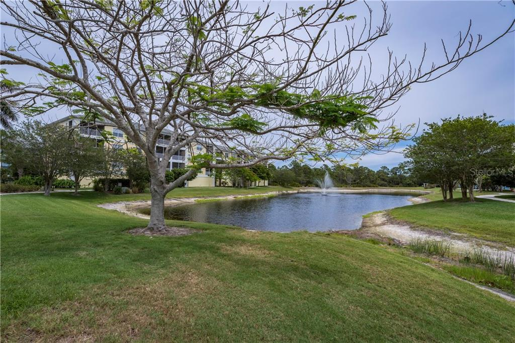View of lake in resort complex. - Condo for sale at 8413 Placida Rd #403, Placida, FL 33946 - MLS Number is C7401304