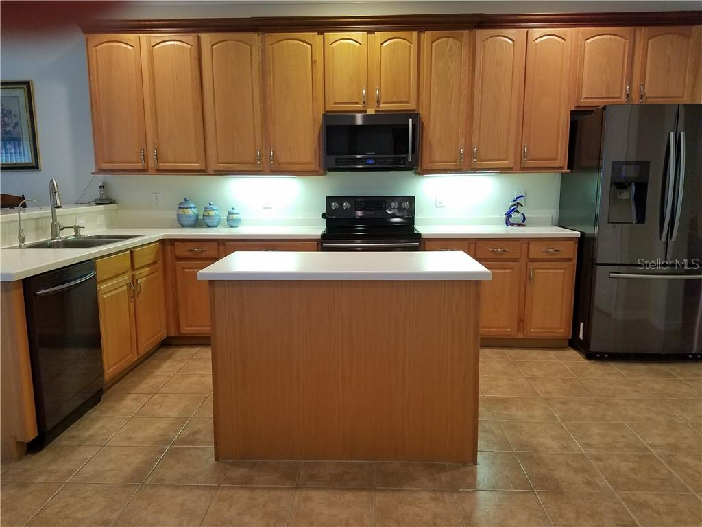 Ample  sized kitchen features all new appliances and Corian Coutertops. - Single Family Home for sale at 2752 Suncoast Lakes Blvd, Punta Gorda, FL 33980 - MLS Number is C7402671