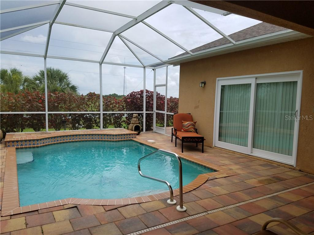 Lounge poolside and enjoy!!! - Single Family Home for sale at 2752 Suncoast Lakes Blvd, Punta Gorda, FL 33980 - MLS Number is C7402671