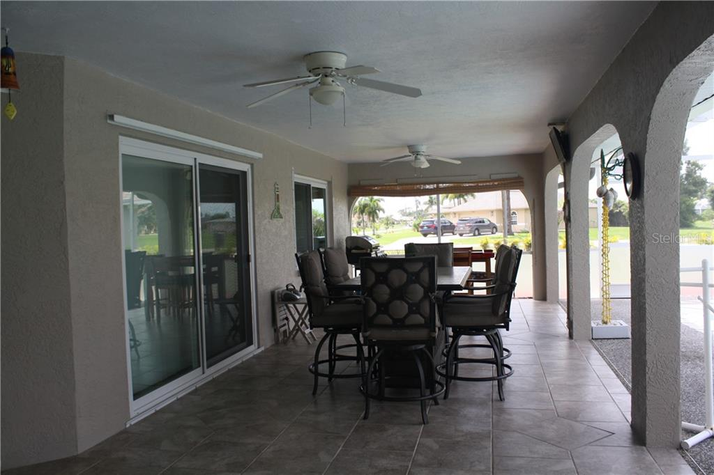 Covered lanai with ceiling fans. - Single Family Home for sale at 25378 Rupert Rd, Punta Gorda, FL 33983 - MLS Number is C7403652