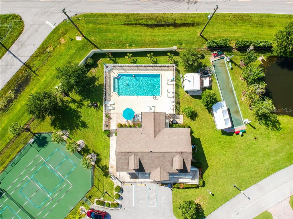 View of the pool and the bocce ball court - Single Family Home for sale at 8663 Lake Front Ct, Punta Gorda, FL 33950 - MLS Number is C7403960