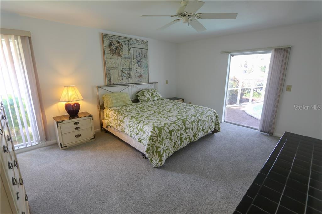 Master bedroom with slider out to the pool area. - Single Family Home for sale at 4449 Crews Ct, Port Charlotte, FL 33952 - MLS Number is C7405049