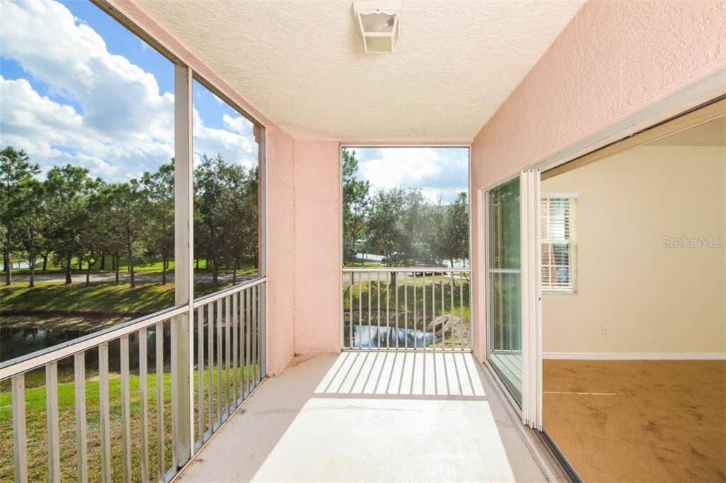 Two-sider screened rear porch is a bird watchers delight. - Condo for sale at 2040 Willow Hammock Cir #b208, Punta Gorda, FL 33983 - MLS Number is C7408424