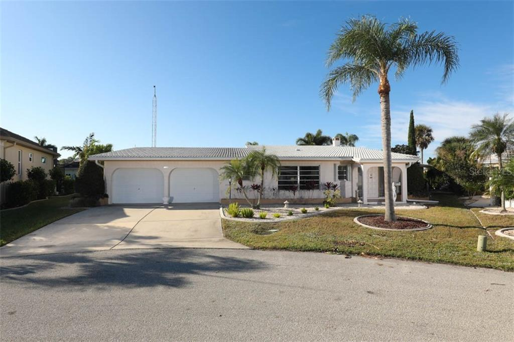 Double window is at Library. Wide concrete driveway. - Single Family Home for sale at 2291 Bayview Rd, Punta Gorda, FL 33950 - MLS Number is C7409445