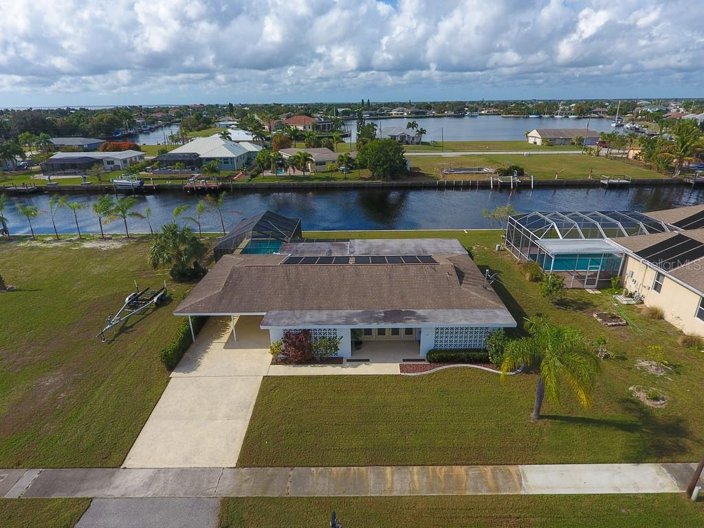 Wonderful waterfront neighborhood- a boater's dream. - Single Family Home for sale at 126 Bangsberg Rd Se, Port Charlotte, FL 33952 - MLS Number is C7409866